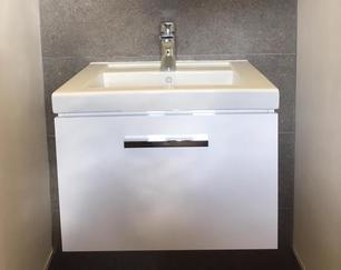 Contemporary wall-hung Roca sink and tap